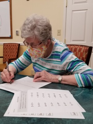 Woman filling out forms.